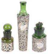Three silver and emerald green glass perfume bottles