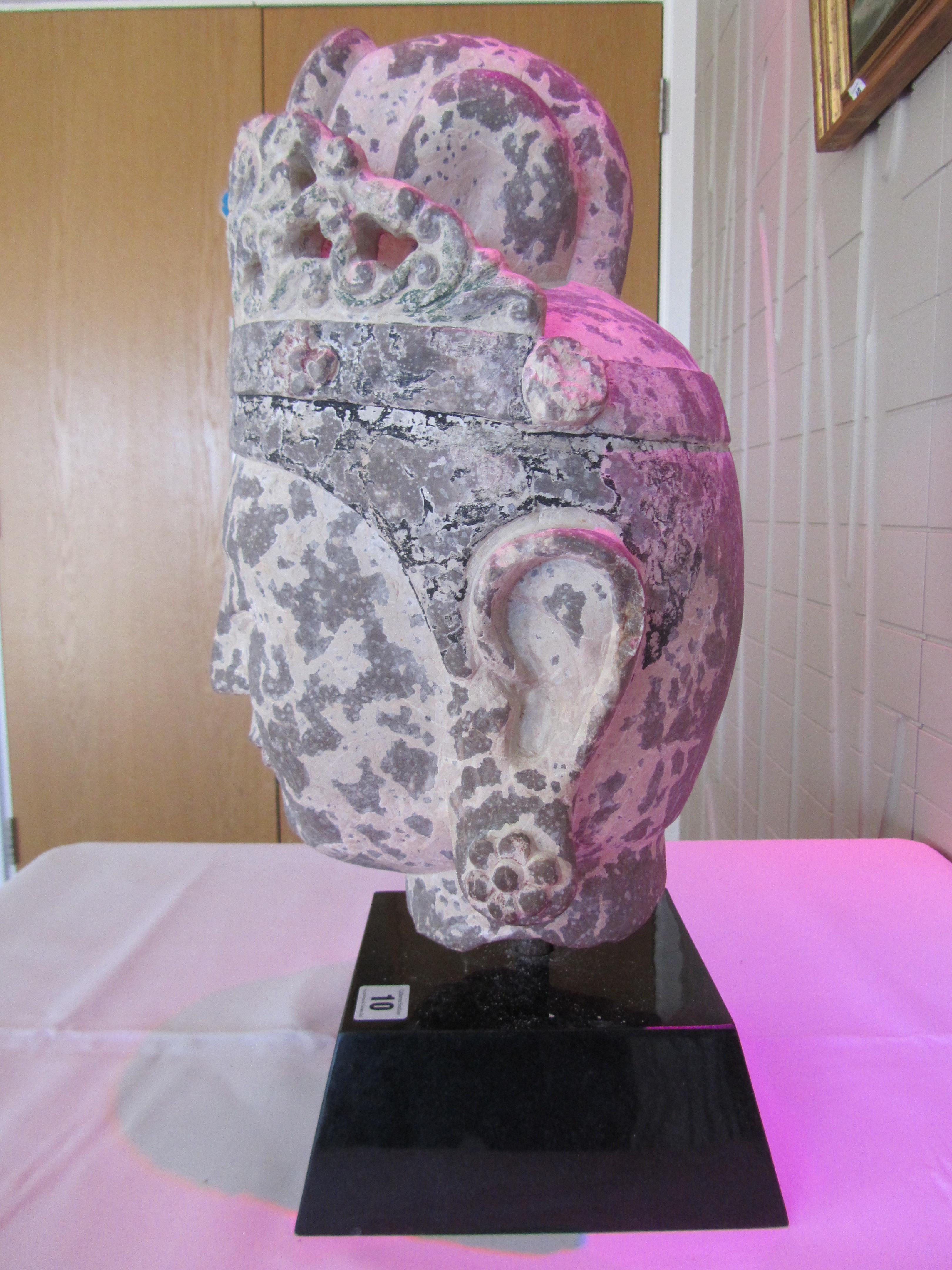 Lot 10 - A large Chinese carved stone head of the Buddha in archaic style