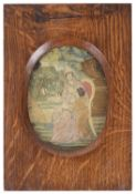 A small early 19th century silk needlework picture of a mother and child
