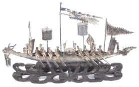 A Chinese Cumow silver model of a dragon boat in original postage bag, mid 19th century