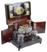 A late Victorian tabletop cabinet decanter set