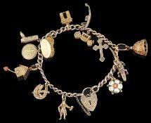 A Continental yellow metal charm bracelet