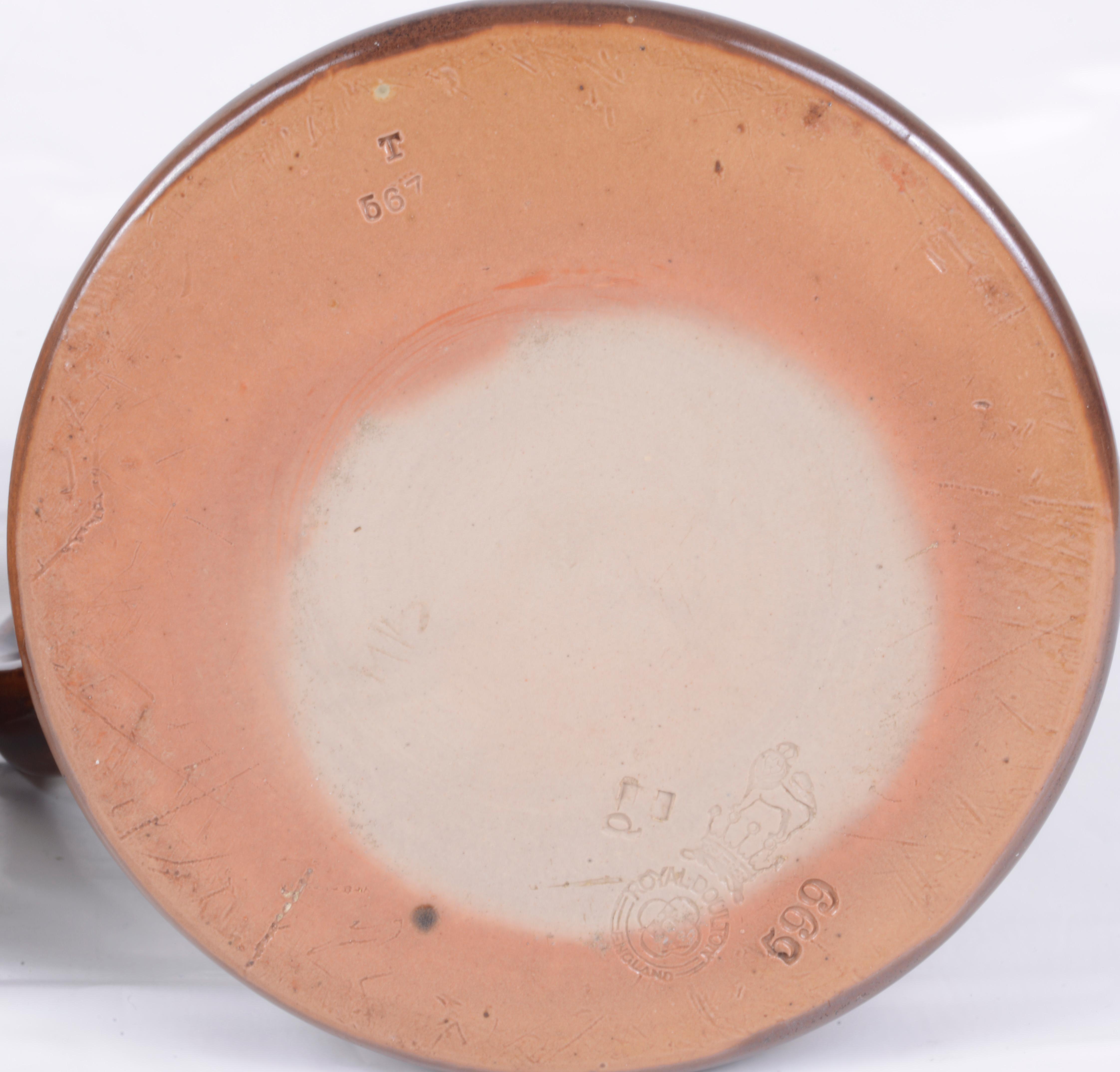 Lot 57 - A pair of Royal Doulton stoneware silver rimmed tankards