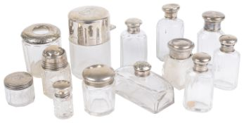 A collection of silver topped glass dressing table and vanity case jars and bottles