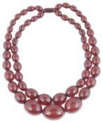 An Art Deco double row cherry amber bead necklace