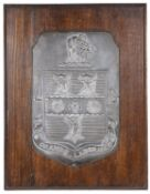 A wooden mounted shield plaque bearing coat of arms for Rugby School by Fisher and Ludlow