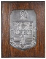 Lot 12 - A wooden mounted shield plaque bearing coat of arms for Rugby School by Fisher and Ludlow