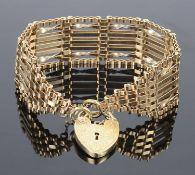 A fancy 9ct gold seven bar gate bracelet