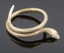 An attractive Victorian style coiled gold snake bracelet