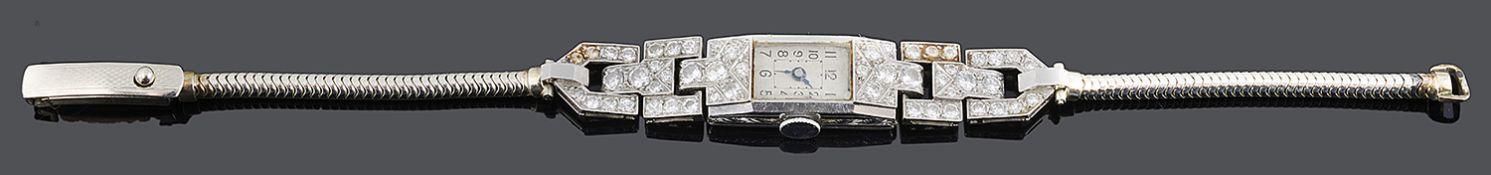 An Art deco platinum and diamond set ladies cocktail watch