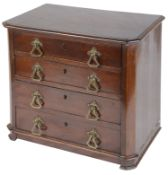 A late Victorian mahogany table top collectors chest of drawers
