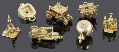 A charming contemporary collection of seven 9ct mostly articulated charms