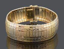 A Continental three colour 18ct gold bracelet