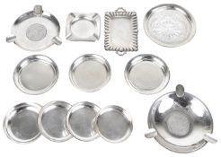 A collection of silver ashtrays