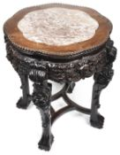 A late 19th c. Chinese export rosewood circular occasional table