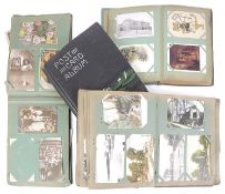Four Edwardian postcard and greeting card albums