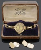 A 18ct gold ladies wristwatch and a set of 9ct gold cufflinks