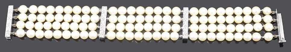 A Continental four row cultured pearl and diamond bar set bracelet