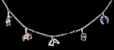 An amusing Art Deco Cartier and other diamond and gem set charm necklace