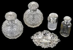 A selection of Victorian silver capped glass scent bottle and a silver trinket tray