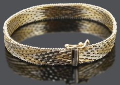 A contemporary 9ct gold brick link woven bracelet