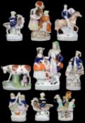 A collection of nine 19th c. Staffordshire pottery figures