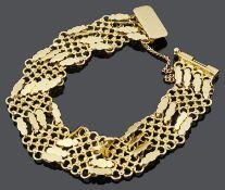 An eastern 18ct gold honeycomb panel bracelet