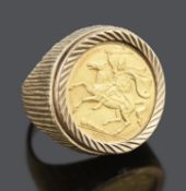A Queen Elizabeth II Isle of man gold half sovereign 1974, mounted in a 9ct gold ring
