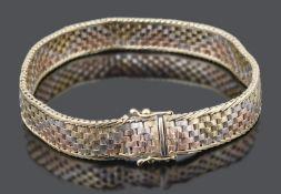 A contemporary 9ct tricolour gold textured brick link bracelet