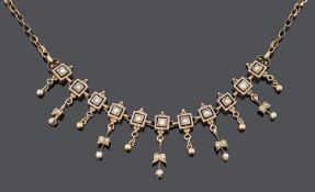 A delicate 19th c. seed pearl set foliate fringe drop necklace