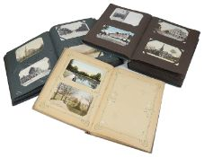 An extensive collection of postcards in three albums