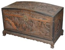 An early 20th c. Chinese carved teak domed blanket chest
