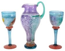 A contemporary Kosta Boda glass Can Can Jug and two matching goblets designed by Kjell Engman