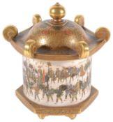 A Japanese Meiji period Satsuma earthenware jar and cover