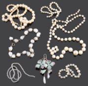 An Continental Art Nouveau enamel and baroque pearl drop pendant