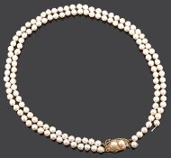 A double row cultured pearl necklace with Chinese yellow metal pearl set fancy clasp