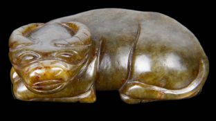 A contemporary Chinese spinach jade carving of a recumbent buffalo