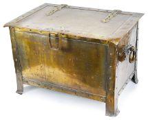 A brass Arts and Craft log bin