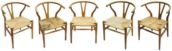 A set of five Hans Wegner (1914-2007) for Carl Hansen & Son Denmark oak CH24 wishbone dining chairs