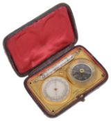 A 19th century brass Fr. pocket barometer, thermometer and compass travelling compendium