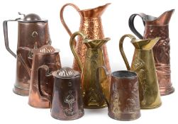 A collection of eight Arts and Crafts mostly Joseph Sankey & Son copper and brass ewers and jugs