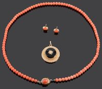 A delicate coral bead necklace and ear studs