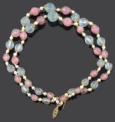An attractive carved pink and green tourmaline bead two row necklace