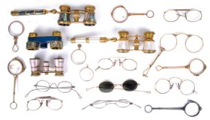 A collection of 19th century opera glasses, lorgnettes, and spectacles