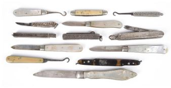 Four Victorian and later silver bladed and mother of pearl folding fruit knives,
