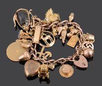 A heavy 9ct rose gold curb link charm bracelet
