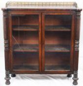 A Regency mahogany glazed dwarf cabinet bookcase