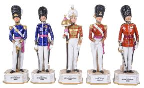 Five German porcelain figures of soldiers