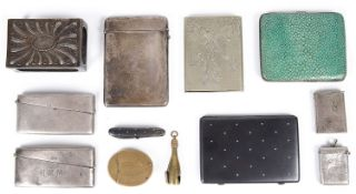 A late Victorian William Comyns silver match box cover, silver card cases and other items