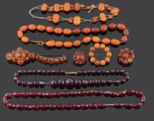 A small collection of Victorian amber brooches and other amber